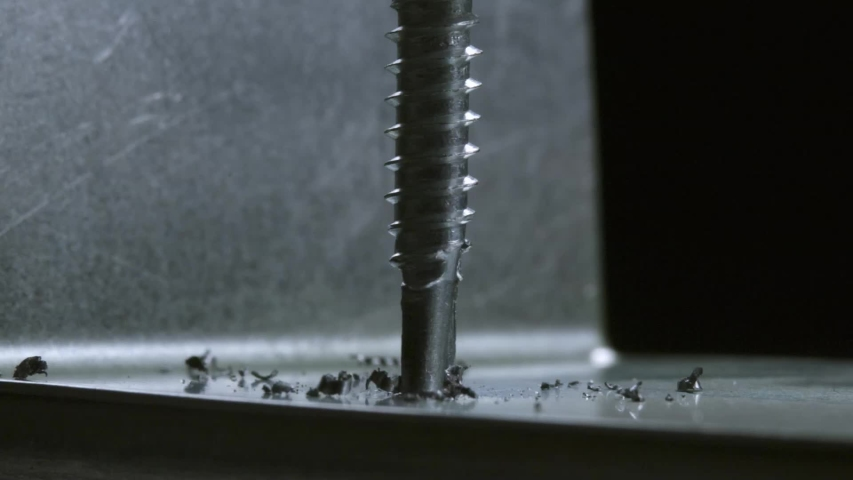 Under a pleasant light, screw on a metal surface. The drill machine drills metal. | Shutterstock HD Video #1053144692