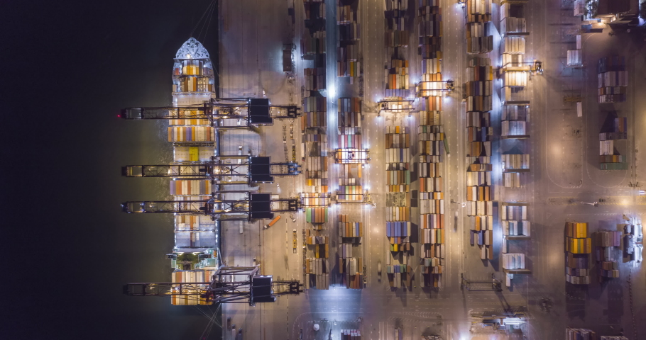 Aerial hyperlapse bird�s eye view of trucks and cranes moving containers at night in Santos port. Sao Paulo, Brazil