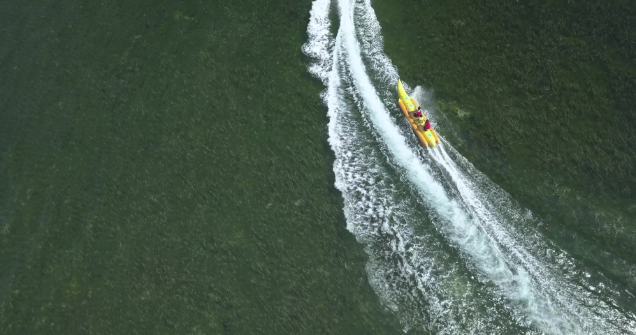 Aerial view of motorboat and banana boat, Nusa Dua, Bali, Indonesia | Shutterstock HD Video #1053148610