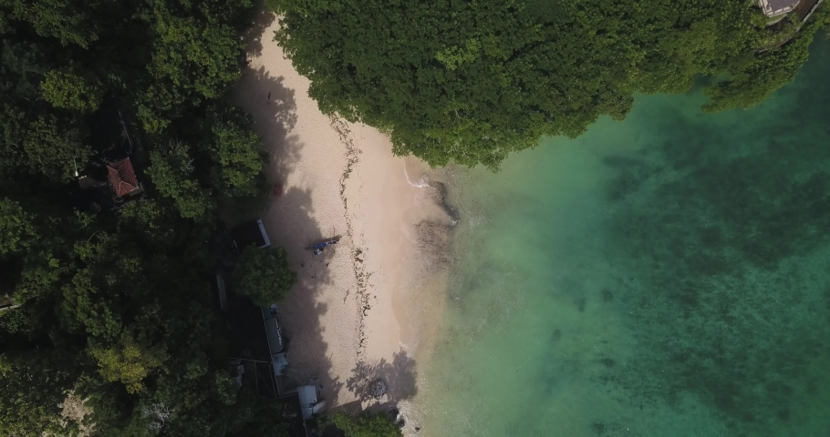 Aerial view of Padang Padang beach, Bali, Indonesia | Shutterstock HD Video #1053148622