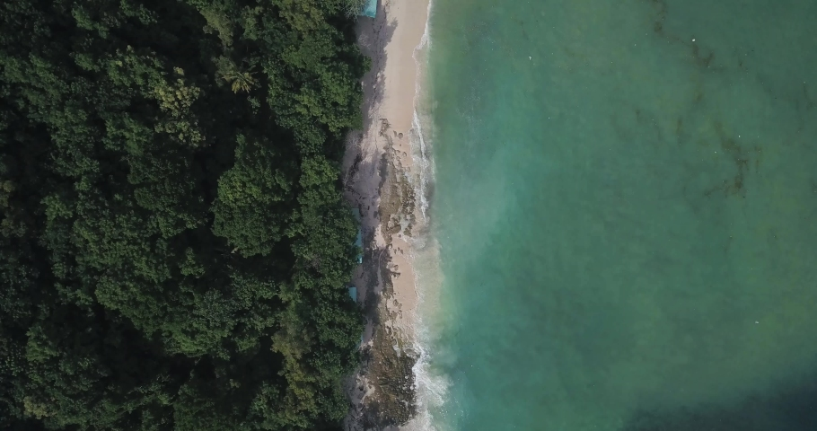 Aerial view of Thomas beach, Padang Padang, Bali, Indonesia | Shutterstock HD Video #1053148625