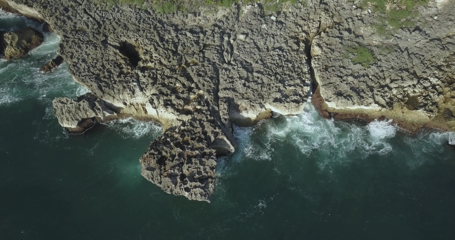 Aerial view of rocky coastline, Nusa Dua, Bali, Indonesia | Shutterstock HD Video #1053148805