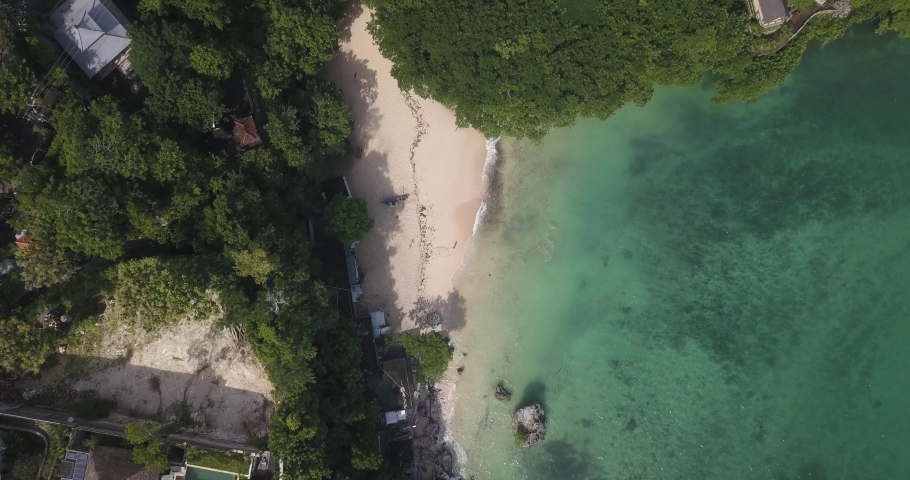 Aerial view of Padang Padang beach, Bali, Indonesia | Shutterstock HD Video #1053148814