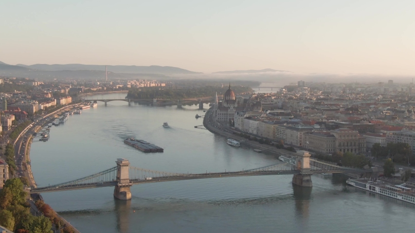Budapest at sunrise with Buda Castle Royal Palace and chain bridge | Shutterstock HD Video #1053153335