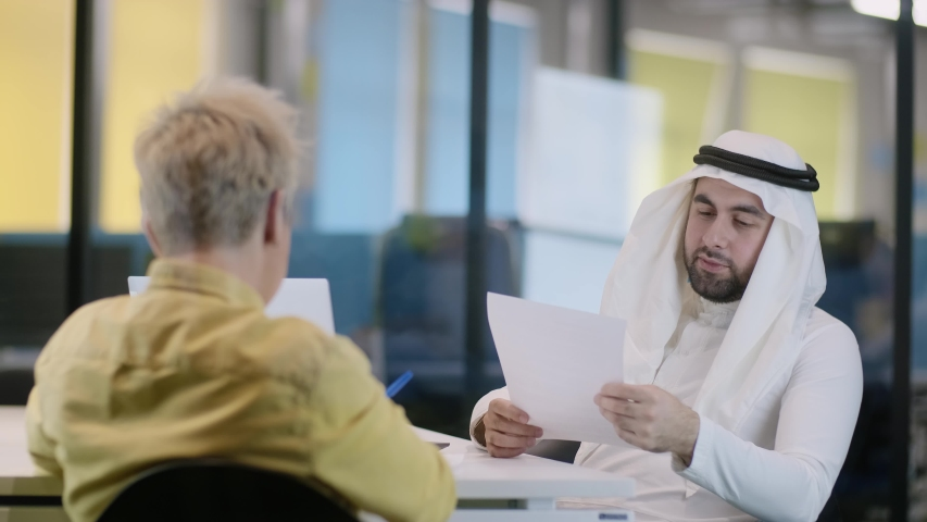 Arab businessman in a business meeting with a partner. Discussion of details before signing the contract. | Shutterstock HD Video #1053157334