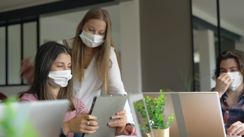 Group of students working wearing masks | Shutterstock HD Video #1053159275
