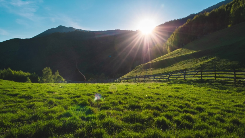 Beautiful green pasture, fresh green grass illuminated by sunset 4k timelapse, simple peaceful rural area landscape in Romania   Shutterstock HD Video #1053160382