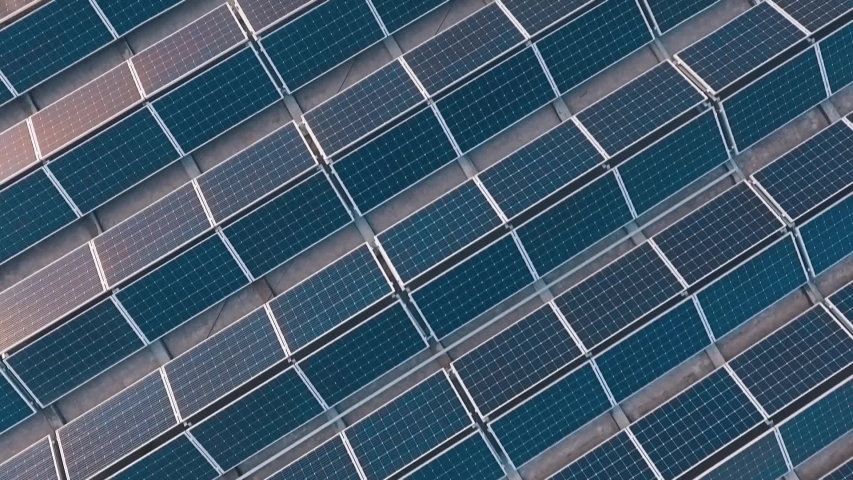 Top view of a new solar farm. Rows of modern photovoltaic solar panels. Renewable ecological source of energy from the sun. Aerial view.