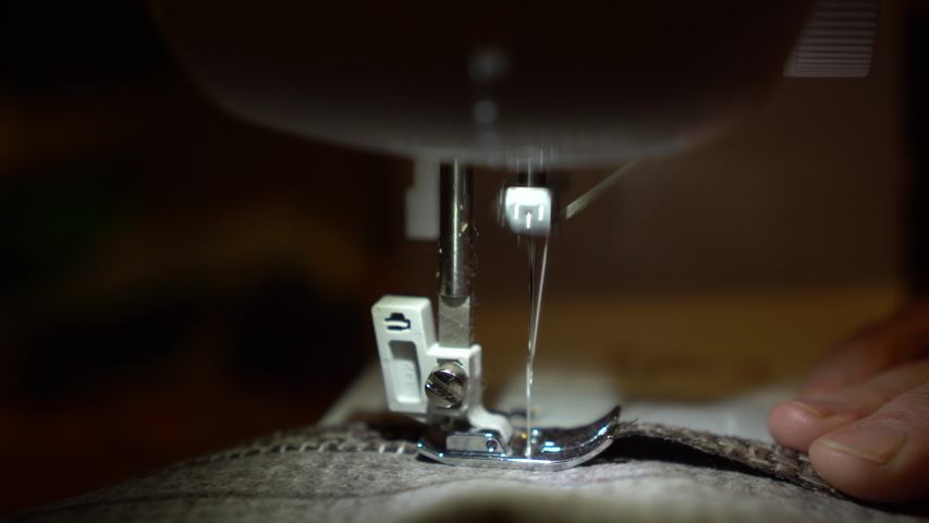 On a sewing machine sew clothes close-up. Dressmaker sews fabric. | Shutterstock HD Video #1053166004