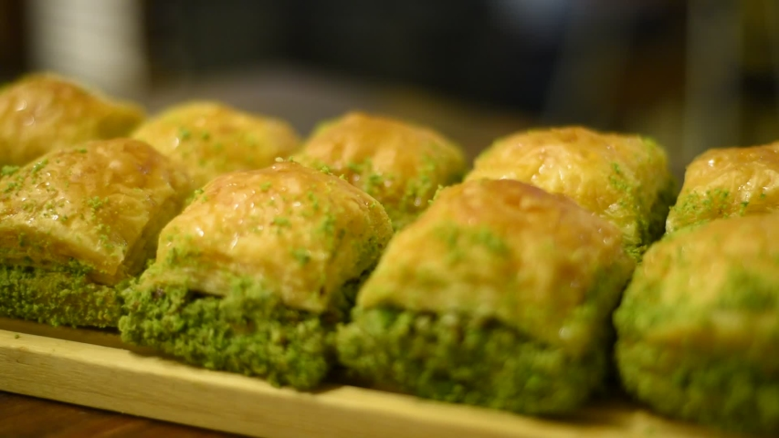 Handmade turkish dessert baklava ..walnut, pistachio turkish style antep baklava presentation and service