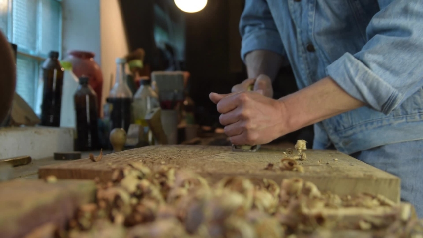 Carpenter with a planer at work in the workshop. Slow-motion close-up   Shutterstock HD Video #1053181919