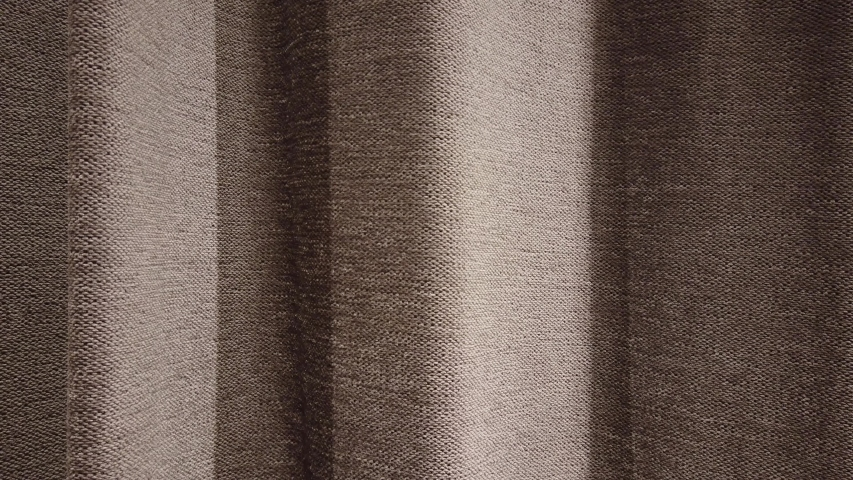 Swinging fabric curtain as a background. Brown curtain in the changing room in a clothing store. | Shutterstock HD Video #1053182468