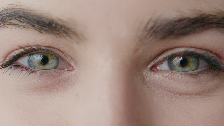 Girl's Blinking Eyes with Beautiful Iris. Close-Up of Two Female Eyes with Moving Pupils and Natural Long Eyelashes. Human Eyes as Incredibly Complex Organ. Slow Motion Cinematic Shot | Shutterstock HD Video #1053186680