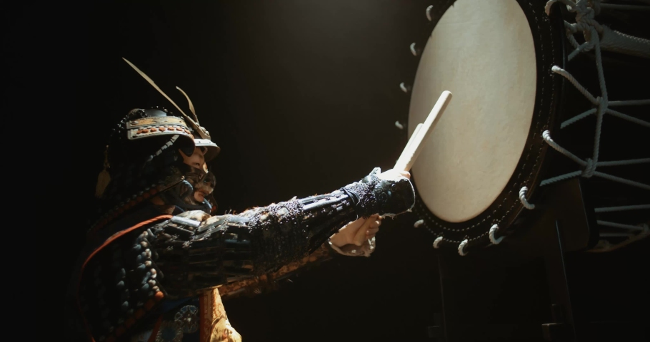 Japanese man in historical samurai costume playing on taiko drum with kata moves, isolated on black background - culture, history concept 4k footage Royalty-Free Stock Footage #1053188483