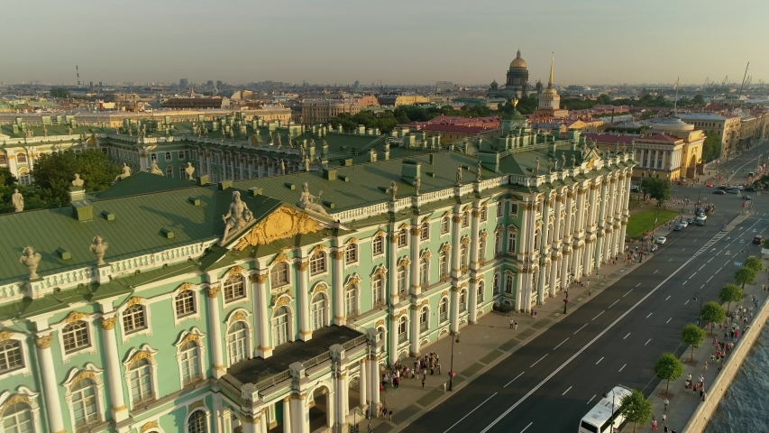 Aerial Saint Petersburg historical cityscape Hermitage Imperial Palace sculpture facade, Main Admiralty, St. Isaac's Cathedral. Road traffic. People walk cross the road. City life Russia. Promenade | Shutterstock HD Video #1053200066
