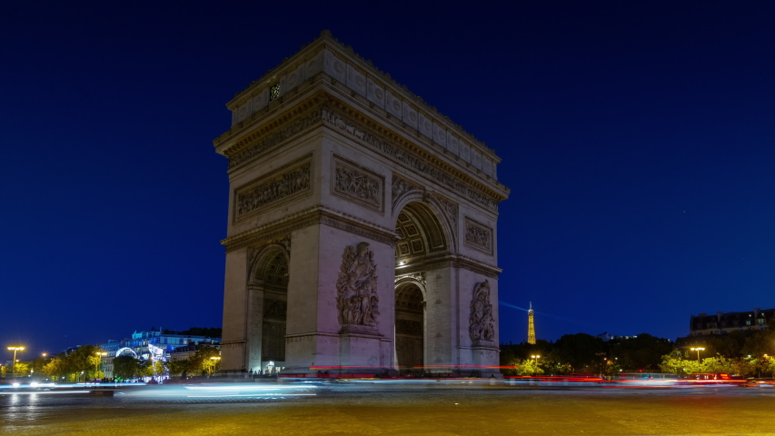 Night illumination paris city famous tourist crowded arch traffic circle timelapse panorama 4k france | Shutterstock HD Video #1053201143