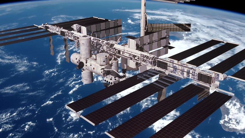 Animation of the International Space Station (ISS) Floating in Orbit above Planet Earth in outer space. Contains public domain image by NASA | Shutterstock HD Video #1053201203