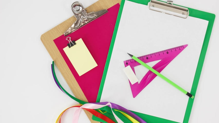 Office consumables and supplies on white table background. | Shutterstock HD Video #1053210233
