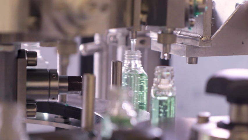Plastic bottles for sanitizers gel are moving along the conveyor belt at the factory for the production of personal protective equipment. Royalty-Free Stock Footage #1053210872