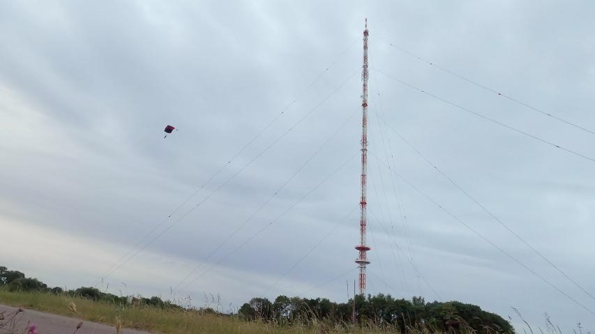 Man BASE jumping from antenna