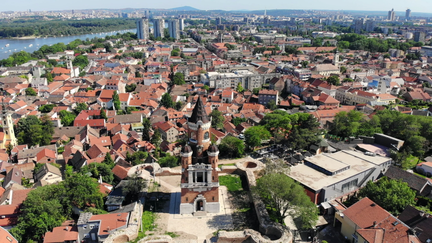 Aerial drone video of Gardos tower in Zemun, an old municipality of Belgrade, Serbia. City skyline. | Shutterstock HD Video #1053215120