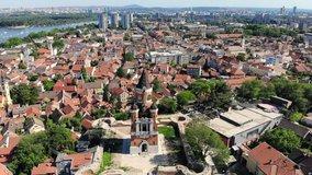 Aerial drone video of Gardos tower in Zemun, an old municipality of Belgrade, Serbia. City skyline.