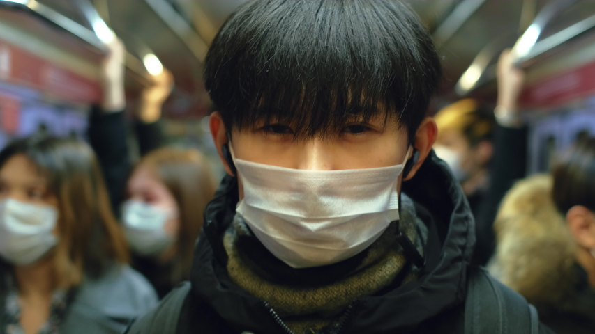 Asia Infect Corona Virus. Face Mask Covid-19 Subway Tube. Chinese Passenger. Epidemic Coronavirus Asian Man. Pandemic Flu Corona Virus. Crowd Masked 2019-ncov. Train Metro China. People Sick Covid 19. Royalty-Free Stock Footage #1053216605