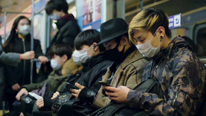 Asia Infect Corona Virus. 2019-ncov. Face Mask Covid-19 Subway Tube. Chinese. Epidemic Coronavirus Asian Man. Pandemic Flu Corona Virus. Crowd Masked 2019-ncov. Train Metro China. People Sick Covid 19 Royalty-Free Stock Footage #1053216608