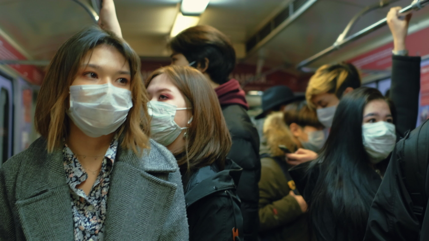 Asia Infect Corona Virus. Face Mask Covid-19 Subway Tube. Chinese Passenger. Epidemic Coronavirus Asian Man. Pandemic Flu Corona Virus. Crowd Masked 2019-ncov. Train Metro China. People Sick Covid 19. Royalty-Free Stock Footage #1053216617