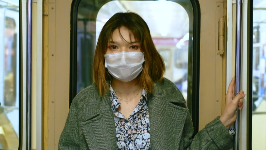 Asia Infect Corona Virus. Face Mask Covid-19 Subway Tube. Chinese Passenger. Epidemic Coronavirus Asian Girl. Pandemic Corona Virus. Crowd Masked 2019-ncov. Train Metro China. People Sick Hong Kong, Royalty-Free Stock Footage #1053216665