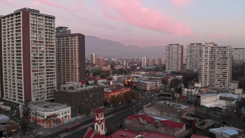 Aerial view of Nunoa and the Andes as background from Santiago Centro commune in Santiago de Chile | Shutterstock HD Video #1053218357