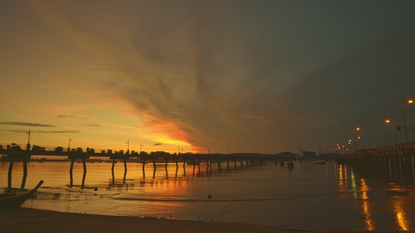 Scenery sunrise Chalong pier. Chalong pier very important for travel business it is a center for all boat  and yacht marina there have two piers for transport service tourists  | Shutterstock HD Video #1053218729