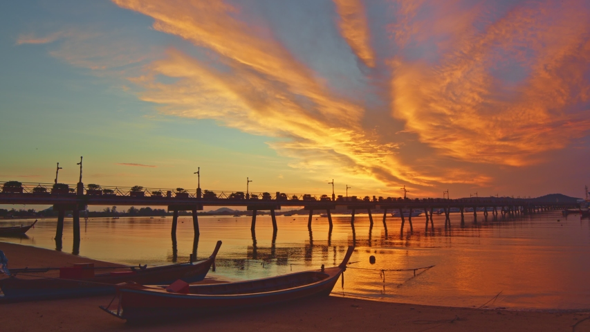 Scenery sunrise Chalong pier. Chalong pier very important for travel business it is a center for all boat  and yacht marina there have two piers for transport service tourists  | Shutterstock HD Video #1053218732