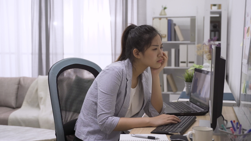 Focused serious pensive asian korean businesswoman in smart casual suit solving business problem working on computer looking at screen. worried puzzled female executive managing stock market risks. | Shutterstock HD Video #1053220004