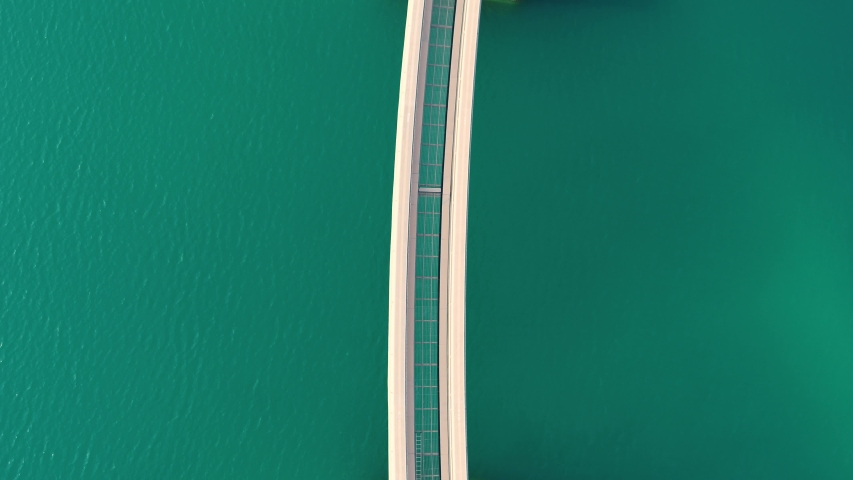 Aerial view of the monorail on the Palm Jumeirah in Dubai, United Arab Emirates. | Shutterstock HD Video #1053232046