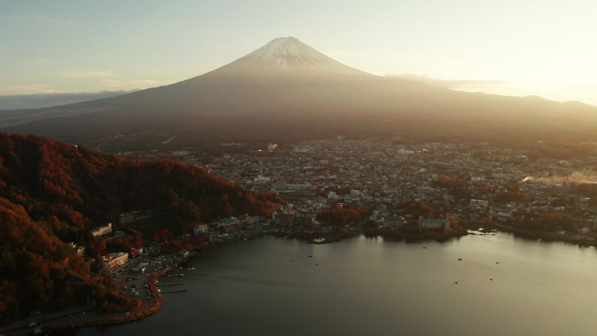 Mt. Fuji in autumn at sunset at lake Kawaguchiko, Japan. Aerial view | Shutterstock HD Video #1053232220