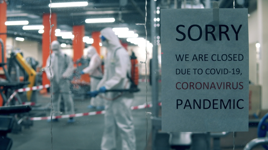 Disinfectors are sanitizing closed gym during pandemic