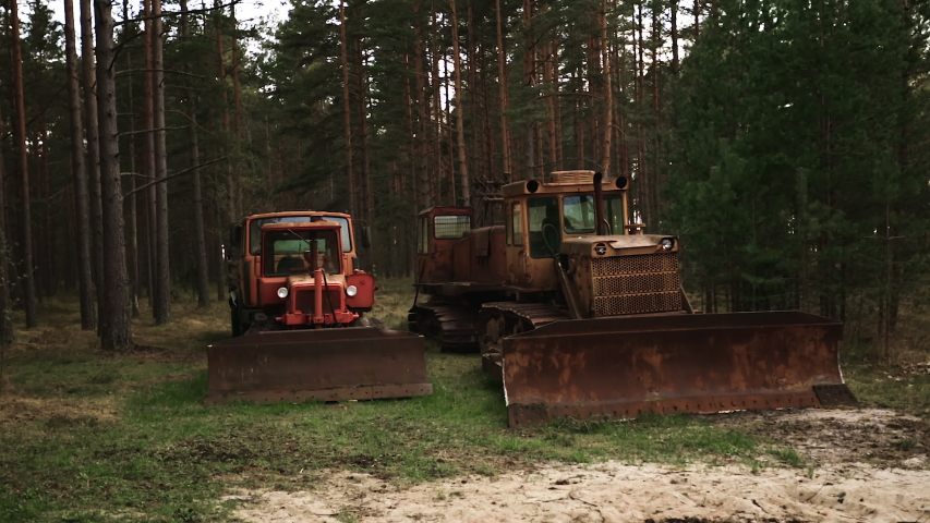 Three old rusty abandoned tractors with huge loader buckets | Shutterstock HD Video #1053240023