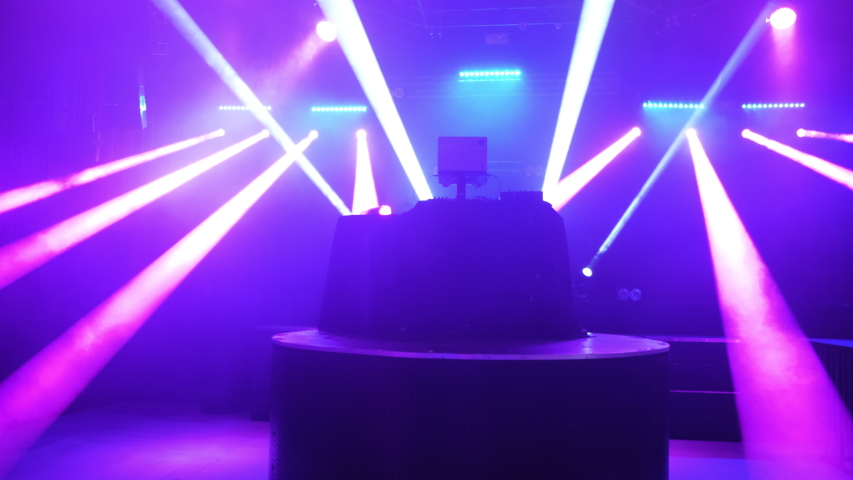 Pink rays of light in the night club empty dance floor static wide angle Royalty-Free Stock Footage #1053247493