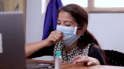 Sick Girl in medical mask talking or having chat with doctor on video conference - telehealth, telemedicine or tele counseling with Nurse or Doctor during coronavirus or covid-19 crisis.