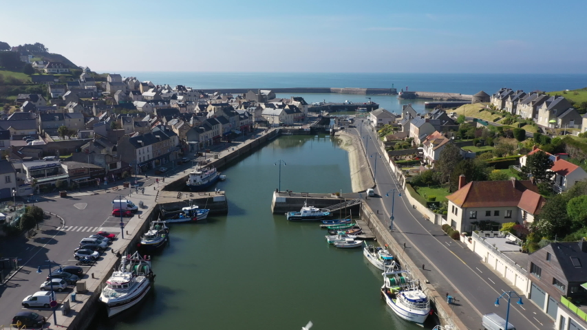 Aerial view of the city of Port-en-Bessin and its port. Port-en-Bessin is a commune in the Calvados department in the Basse-Normandie region in northwestern France. | Shutterstock HD Video #1053255092