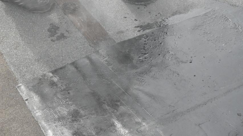 Roof partial repair, fill cracks with tar. A quick roof repair. Improper roof repair. | Shutterstock HD Video #1053270728
