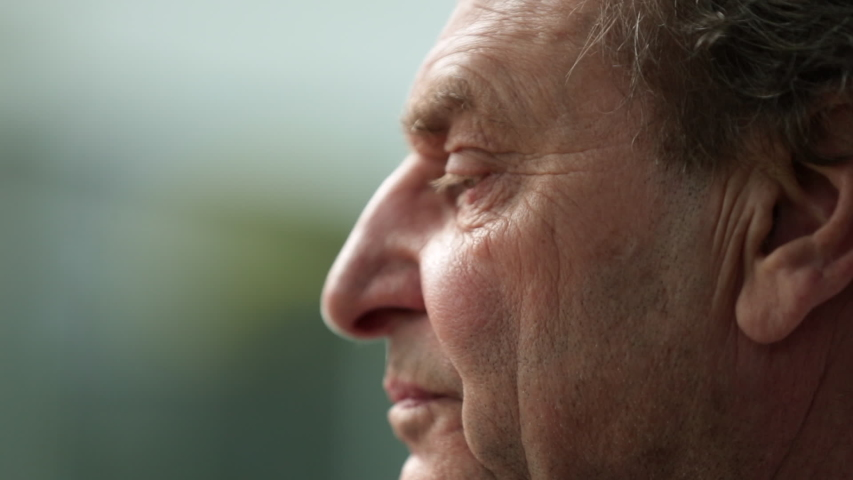 Pensive older man thinking. Contemplative senior man face.