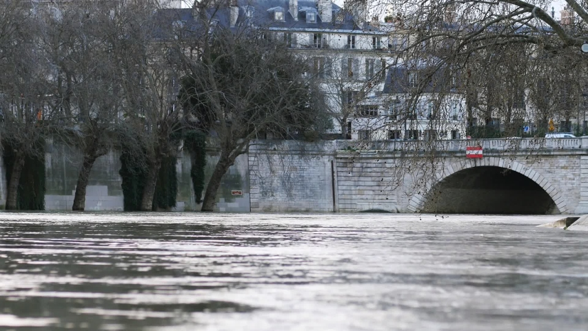 Flooding of the Seine in Paris during the winter. View of the river and the water rising.   Shutterstock HD Video #1053277832