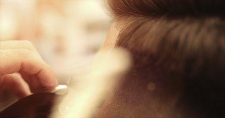 Barber make a beard contour, beard haircut. Men's beard haircut in a barbershop. Video 4k.