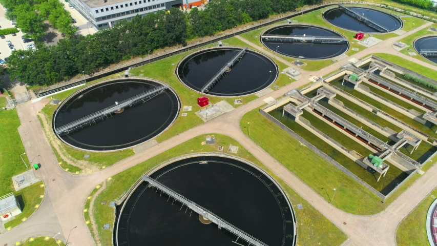 Wide aerial of water purification circle, clean drinking water. Ecosystem of filtration, fresh water and watermanagement. Sewage treatment plant in the sun.