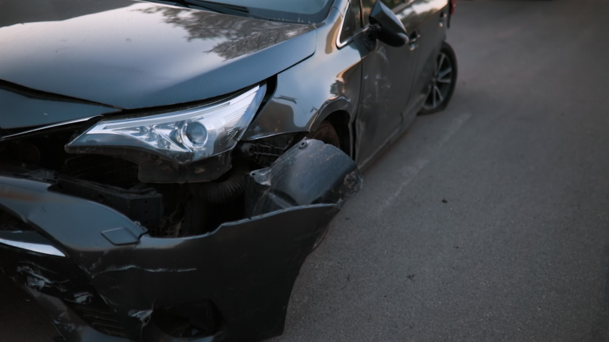 Wrecked new black car on road front view | Shutterstock HD Video #1053287579