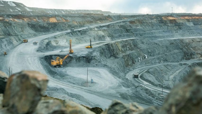 Timelapse video work of equipment on an open pit for gold mining  Royalty-Free Stock Footage #1053289415