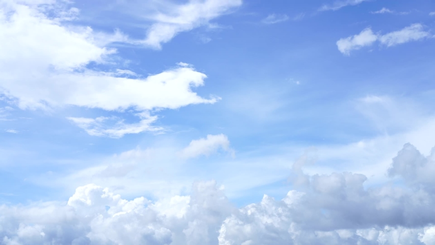 Beautiful sky at a blue background with a lot of clouds.