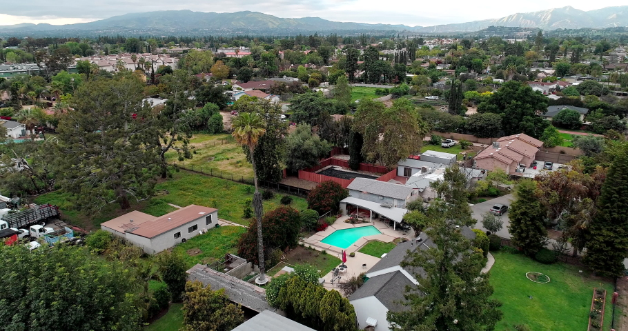 People Stay At Home In North Hills, San Fernando Valley, Los Angeles, California, USA During Coronavirus Pandemic To Prevent Spreading Of The Disease - aerial shot tracking forward over suburban homes | Shutterstock HD Video #1053291743